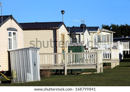 Row of static trailers in caravan park, Scarborough, England. - stock photo