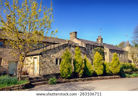 Row of stone cottages in Wycoller. - stock photo