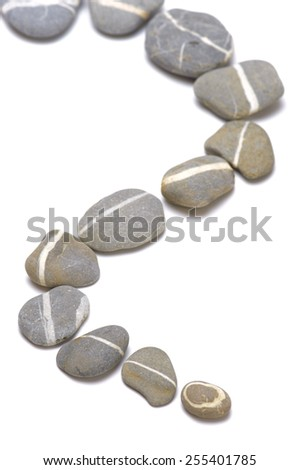 row of stones shows a abstract way over white background - stock photo