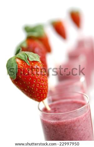 Row of strawberry smoothie - stock photo