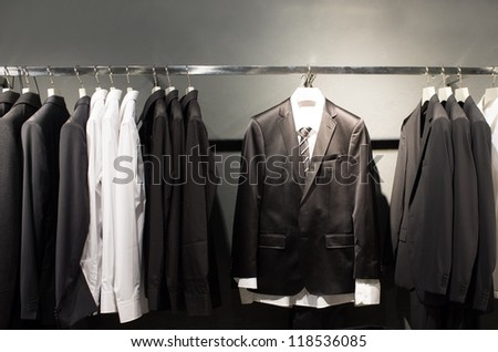 Row of suits in shop - stock photo