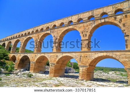 Row of sunny arches of Pont du Gard, Nimes, France