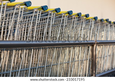Row of supermarket shopping cart trolleys - stock photo