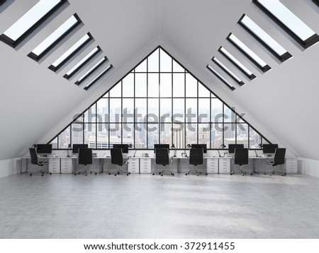row of tables in front of a big triangle window in an office situated in the attic. Computers and stuff on them. City view. Concept of a modern office. 3D rendering - stock photo