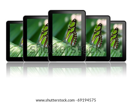 Row of tablet pc's with a butterfly - stock photo