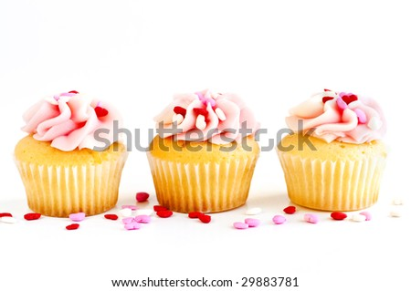 Row of tasty cupcakes with icing and sprinkles