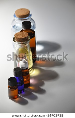 row of the bottle withh massage oil - stock photo