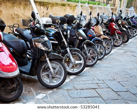 Row of the motorcycles on the old street - stock photo