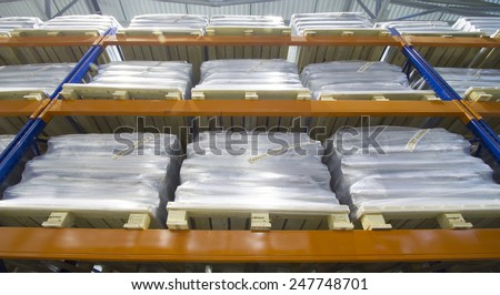 Row of the pallet metal racks with a heavy load in large modern