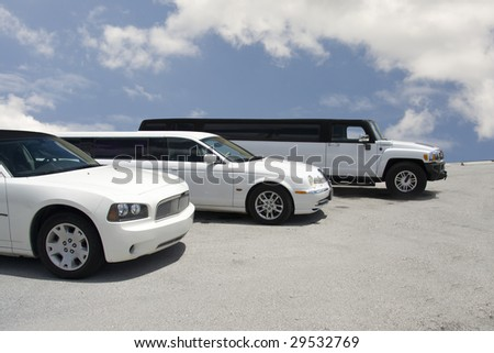 row of three limousines on a blue sky