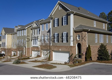 Row of townhomes with garages - stock photo