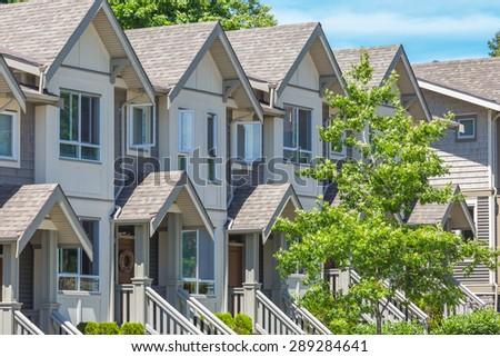 Row of townhouses in a nice neighborhood. - stock photo
