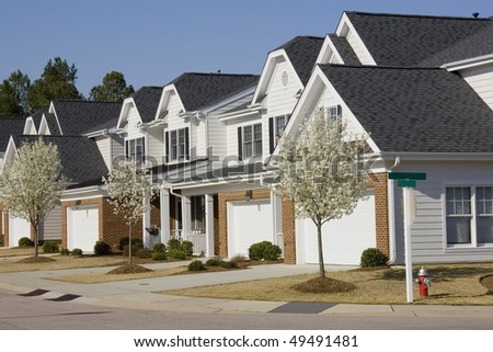 Row of townhouses in springtime - stock photo