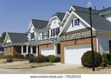 Row of townhouses with garage - stock photo