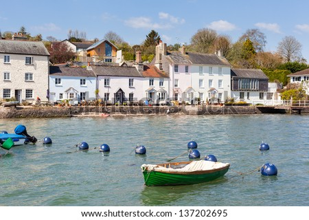 Row of Traditional Cottages line the edge of the River Dart at Dittisham in South Devon, England - stock photo