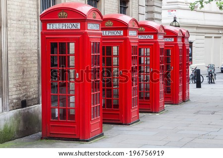row of traditional phone boxes in London city - stock photo