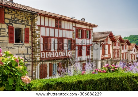 Row of typical Basque cottages in La Bastide-Clairence - stock photo