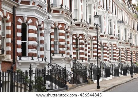 Row of upmarket London houses in Kensington and Chelsea Kensington and Chelsea London 2015 Entrances London upmarket houses - stock photo