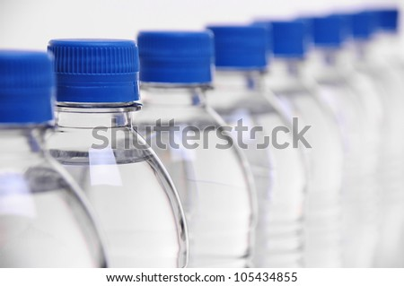 row of water bottle lids with select focus on second bottle - stock photo
