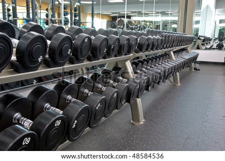 Row of weights - stock photo