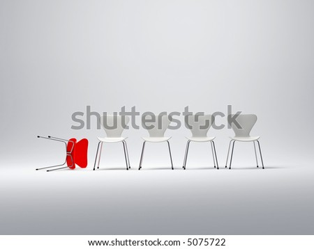 Row of white chairs and a red one follen down - stock photo