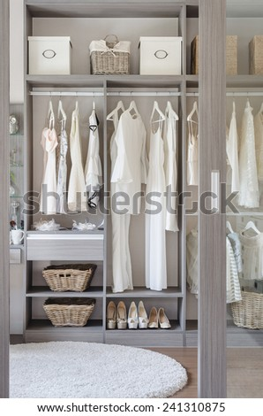 row of white dress with shoes in wardrobe at home - stock photo