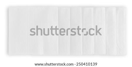Row of white paper napkins isolated on white background - stock photo