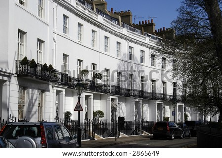 row of white victorian houses - stock photo