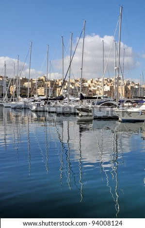 Row of white yachts in the port - stock photo