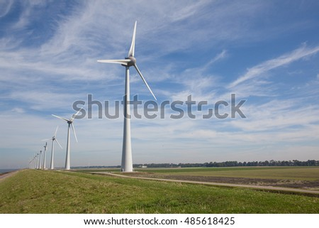 Row of windturbines at the IJsselmeer in the Netherlands