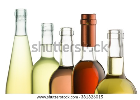 row of wine bottles with red,white and rose wine - stock photo