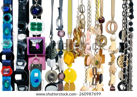 Row of woman many belts - stock photo