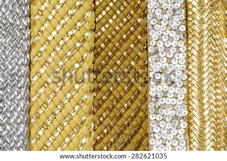Row of woman many belts texture - stock photo