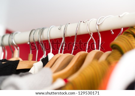 Row of women's clothes hanging in closet - stock photo