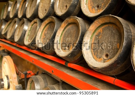 Row of wooden beer barrels. XIX century. - stock photo