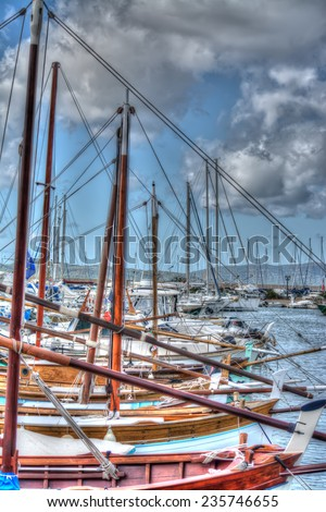 row of wooden boat in Sardinia, Italy. Shot in Alghero port. Processed for hdr tone mapping effect. - stock photo