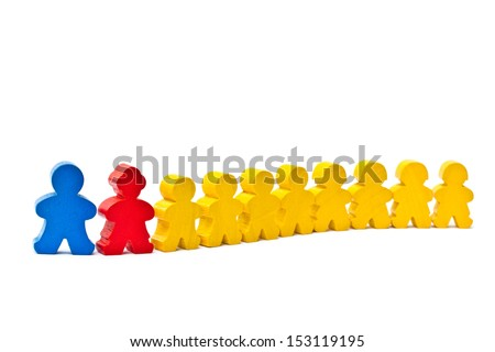 Row of wooden doll on a white background.