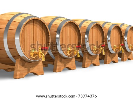 Row of wooden wine barrels with valves