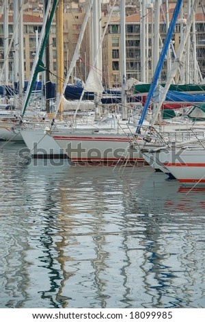 Row of yachts moored in a marina