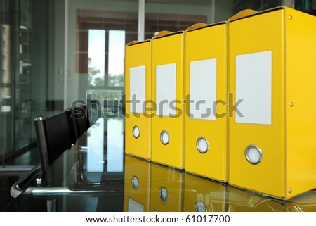 row of yellow folders on desk in office - stock photo