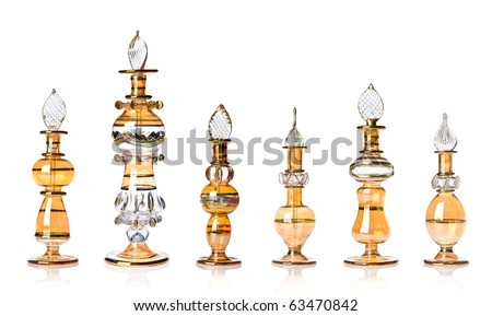 Row of yellow-golden oriental perfume bottles isolated on white.