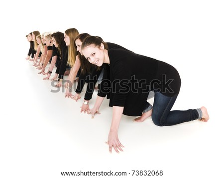 Row of young women in start position isolated on white background - stock photo