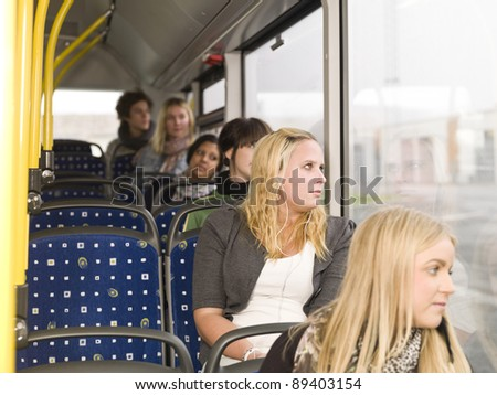 Row of young women on the bus - stock photo