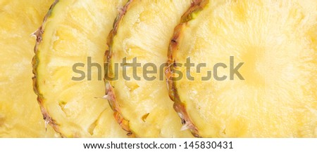 Row sliced pineapple. Close up. Whole background. - stock photo