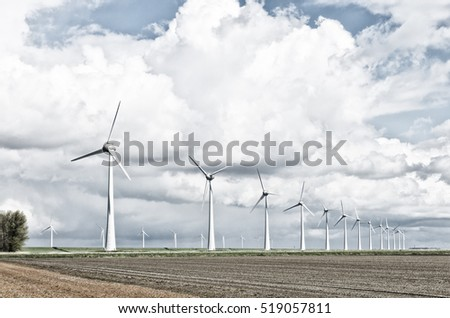 row wind turbines in an agricultural dutch landscape harsh filtered