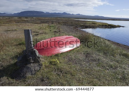 Rowboat at Thingvellir lake in Iceland - stock photo