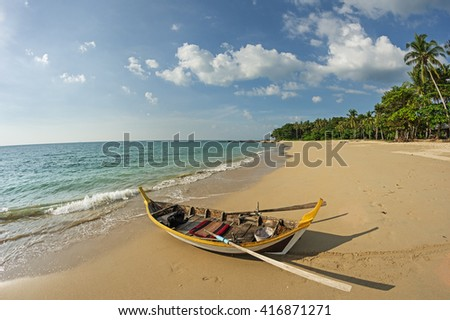 rowboat on a tropical beach in Koh Lanta Thailand - stock photo