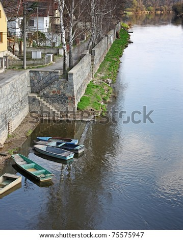 rowboats anchored by bank river Labe, Melnik, Czech Republic