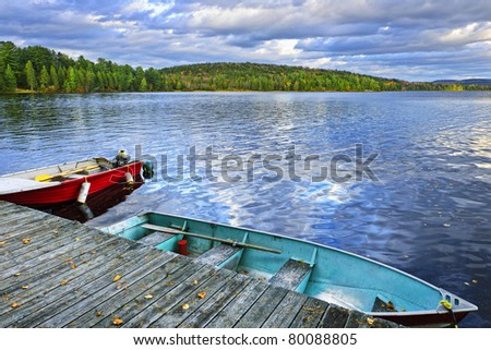 Rowboats docked on Lake of Two Rivers in Algonquin Park, Ontario, Canada - stock photo