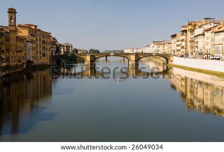 Rowing along the Arno River in Florence, Italy with buildings along the river